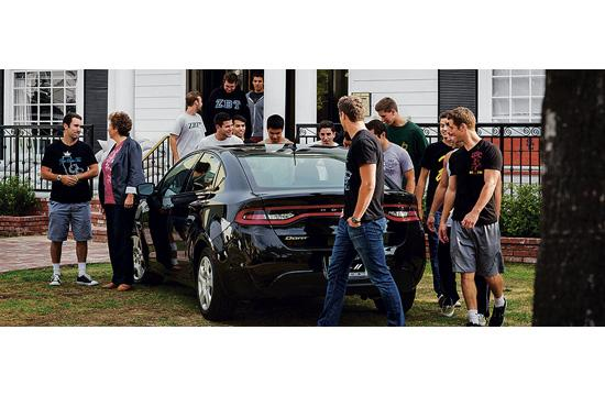 Members of the ZBT fraternity handed the keys to a Dodge Dart to Ellen Rabin of Meals On Wheels West after raising $18
