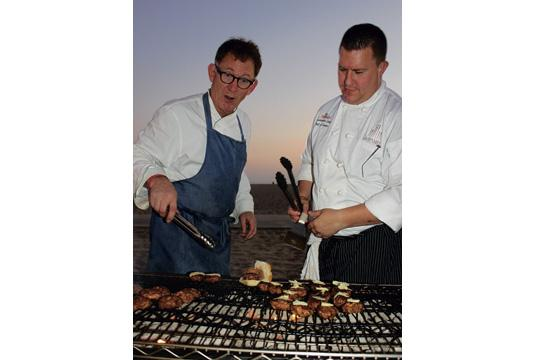 Campanile LAX Executive Chef Mark Peel (left) and Chef du Cuisine Christopher Eddy cook up chorizo sliders with caramelized onions and whole grain mustard.