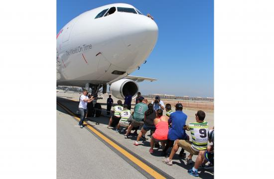 Members of the Santa Monica Dolphins pulled a FedEx Airbus eight times on Saturday.