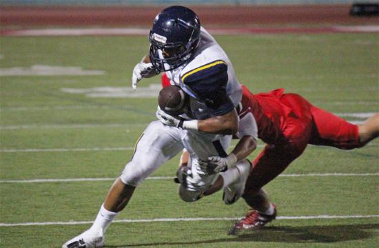 Santa Monica High School receiver Kevin Persons hauls in a 22 yard reception in the fourth quarter with a little over a minute left to play to set up the game winning field goal against Redondo Union Friday night.