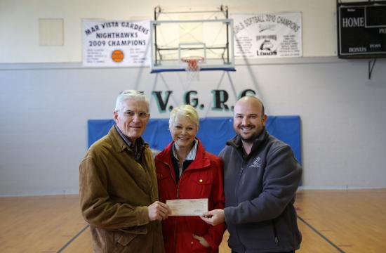 Jack and Cindy Jones present the $1 million check to SMBGC President/CEO Aaron Young (right).