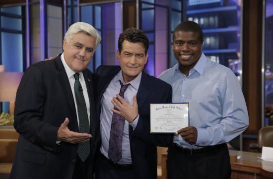 Charlie Sheen receives his Santa Monica High School diploma certificate from Jay Leno and Samohi baseball coach Tony Todd.