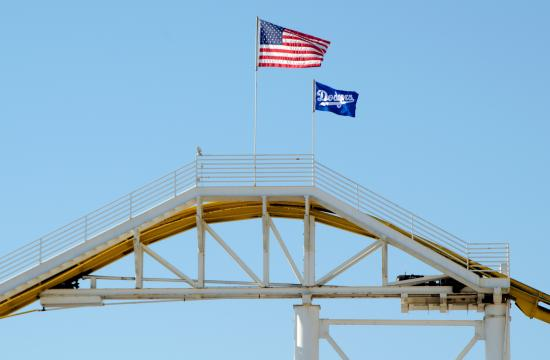 Pacific Park on the Santa Monica Pier displays a high flying Dodgers flag at the roller coaster's peak