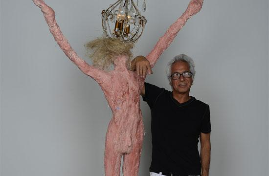 """Yossi Govrin with the sculpture """"Hemp Cement."""""""