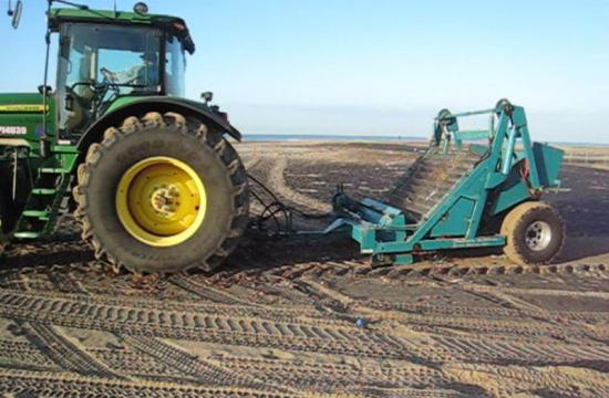 A tractor was used Thursday morning to clear trash from Santa Monica beach after the first flush.
