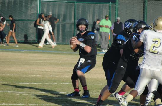 Windward quarterback Connor Simpson helped guide the team to a 47-22 win against Kilpatrick.