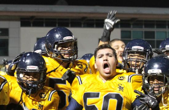 Matthew Galvan (50) and the rest of the Santa Monica High football team is pumped after their victory against Inglewood on Friday night.