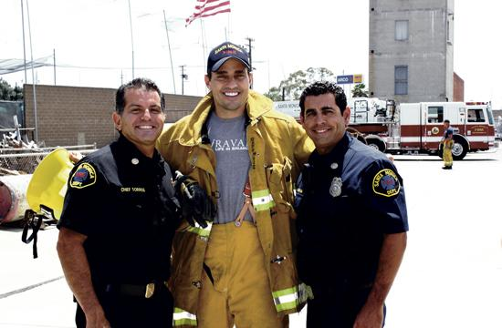 """America Now"" co-host Bill Rancic (center) with SMFD division chief Jose Torres (left) and SMFD Captain Matt Galvan."