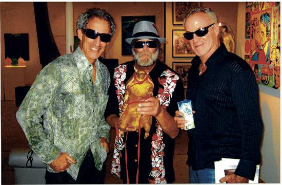 Artist Gary John (center) has gone from living on the streets of Venice to becoming an emerging artist in the past eight months thanks to gallery owners Bruce (left) and Scot Lurie. John's artworks will be featured at the exclusive Art Basel Miami Beach event next month.
