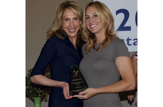 LAcarGuy's Alisha Auringer (right) accepts the 2011 SQA Excellence Award from  Susan Emmer.