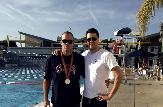 Olympic water polo star Ryan Bailey (left) helps coach at the Santa Monica Splashball and Water Polo Club alongside head coach Karl Niehaus.