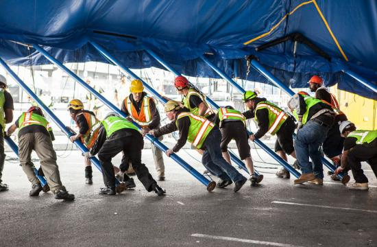 Workers raised the poles to Cirque du Soleil's big top tent on Thursday. Shows begin next Friday