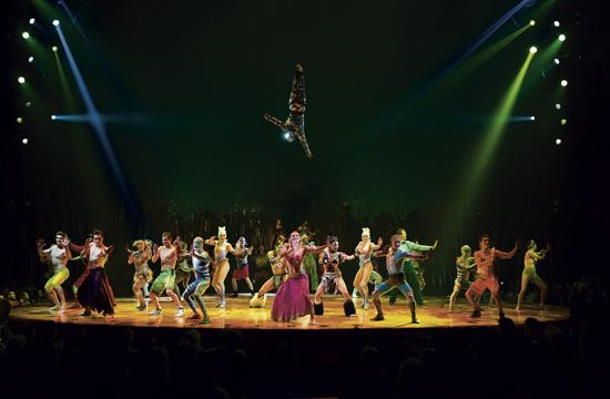 """The Crystal Man hovers over the cast of Cirque du Soleil's touring production of """"Totem."""""""