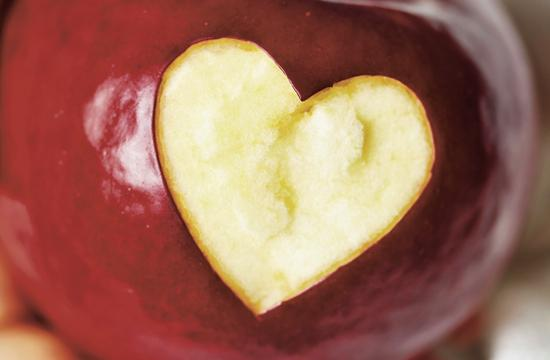 Eating two to three apples per day results in decreased cholesterol levels due to the fruit's rich pectin content.