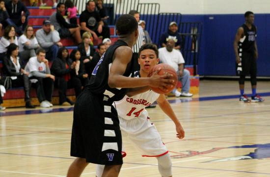 Crossroads' Alexander Miles plays up close defense against a Windward player. Miles had nine points in the Roadrunners' 60-52 defeat to Windward.