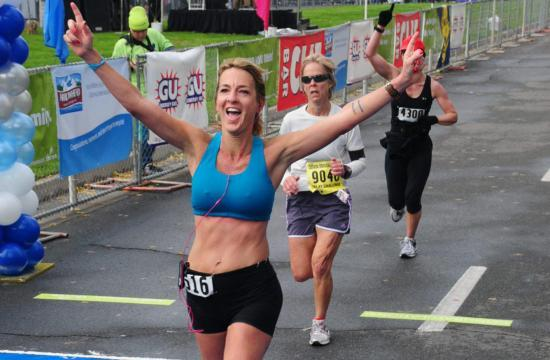Julie Weiss passes the finish line of the California International Marathon in Sacramento December 5