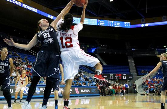 BYU's Lexi Eaton (21) records a block shot against a North Carolina State player during a first round game of the NCAA women's tournament played at Pauley Pavilion.