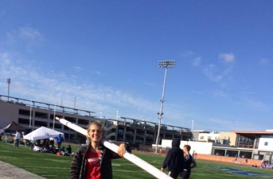 Zita Supernenant carrying her pole vault.