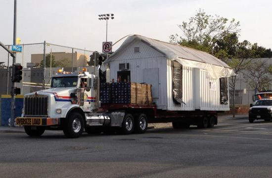 The Shotgun House on the move last Saturday as it went through the intersection of Pico and 4th Street.