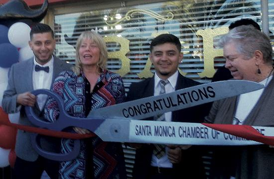 Master Barbers Steve Moran and his partner Robert Echiribel celebrated the grand opening of their new business Active Barbers with Santa Monica Chamber of Commerce president Laurel Rosen and Santa Monica Mayor Pam O'Connor.