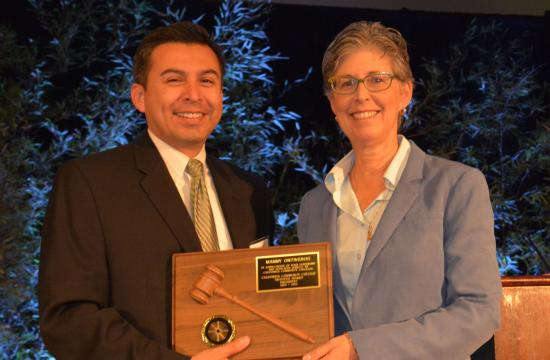 Outgoing 2013-14 CCCT President Manny Ontiveros of the North Orange County Community College District prepares to pass the gavel to SMC Trustee Dr. Louise Jaffe