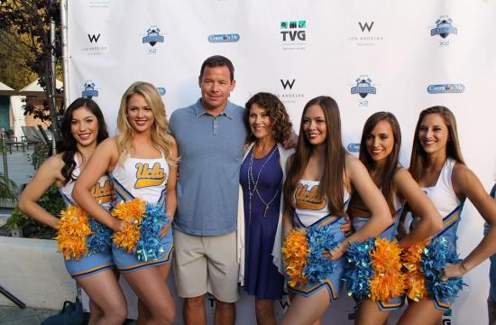 UCLA football coach Jim Mora with wife