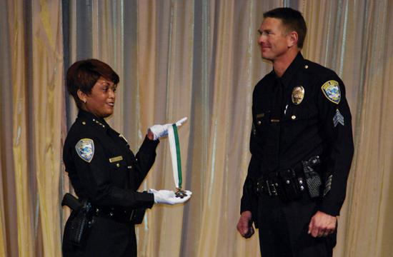 SMPD Sgt. Mike Braaten was presented with the Lifesaving Medal from SMPD chief Jacqueline Seabrooks. Sgt. Braaten saved a child from choking inside a Santa Monica movie theater on the Third Street Promenade on Dec. 31