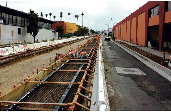 Construction workers are completing track work for the Expo light rail line along Colorado Avenue between 4th and 17th Street.