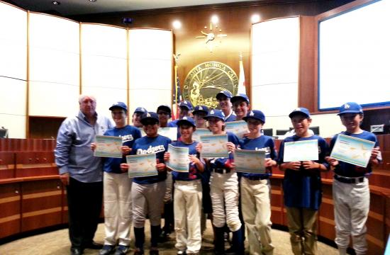 Parks and Recreation chairman Phil Brock honors the SMLL Major Dodgers.