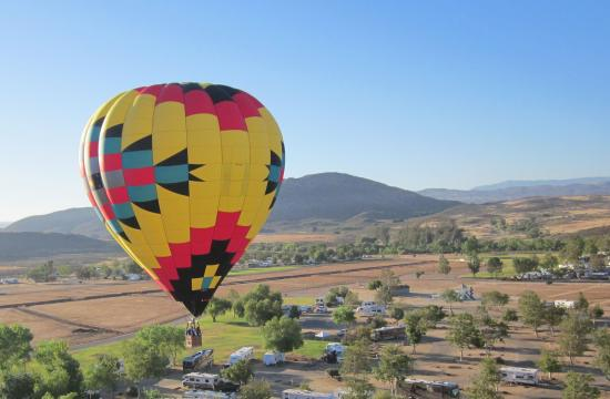 The air is still and peaceful floating thousands of feet over vineyards