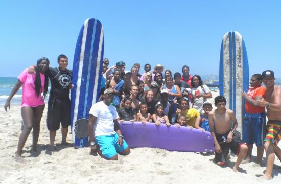 Surf's up at Santa Monica beach for handicapped teenagers from Glendale special needs school.