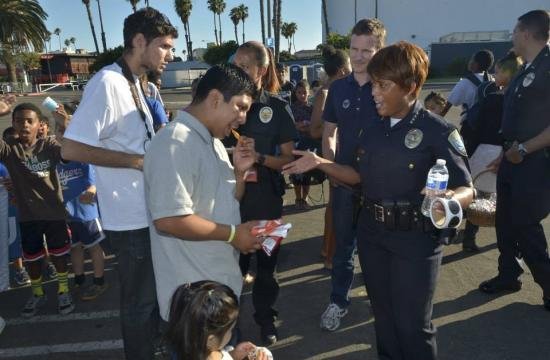 Santa Monica Police Chief Jacqueline Seabrooks talks to one of the National Night Out attendees.