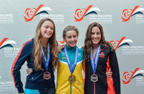 Samohi student Serafina King (left) claimed a bronze medal at Para-Swimming Championships earlier this month. She is pictured next to gold medalist Kathering Downey of Australia (center) and silver medalist Aurelie Rivard of Canada.