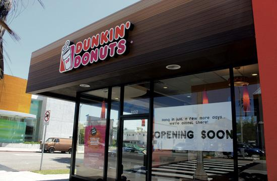 The first person to walk into the new Dunkin' Donuts at 5 am on Tuesday will receive free coffee for a year.