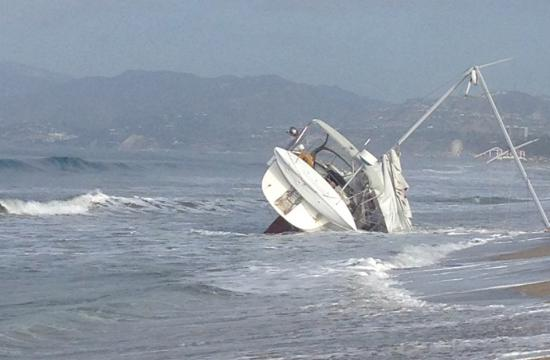 The boat that ran ashore at Venice Beach on early Tuesday morning.