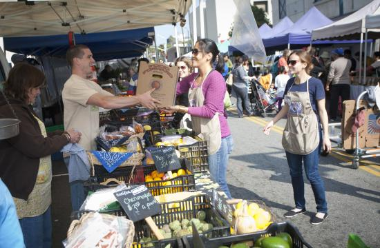 Volunteers from the non-profit organization Food Forward collect unsold produce from the Santa Monica farmers markets that's donated weekly to people in need.