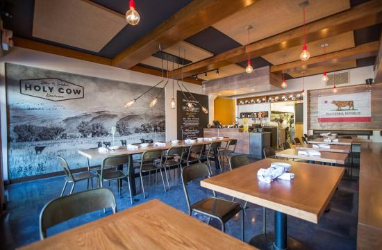 Enjoy BBQ at Holy Cow that's served in a comfortable