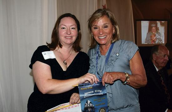 Donna Byrd exchanged banners with visiting Rotarian Kim Schillig from the Downtown Iowa City Club.