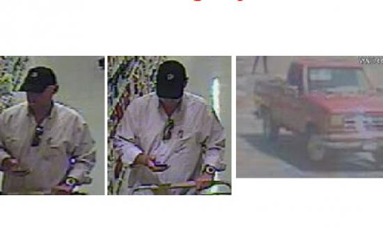 Surveillance footage of the robbery suspect.