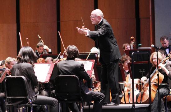 Allen Robert Gross conducting Eroica symphony at Barnum Hall.