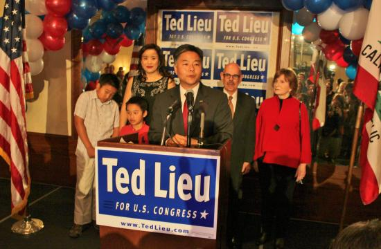 Ted Lieu flanked by his family and Henry and Janet Waxman at the Proud Bird restaurant near LAX on election night.
