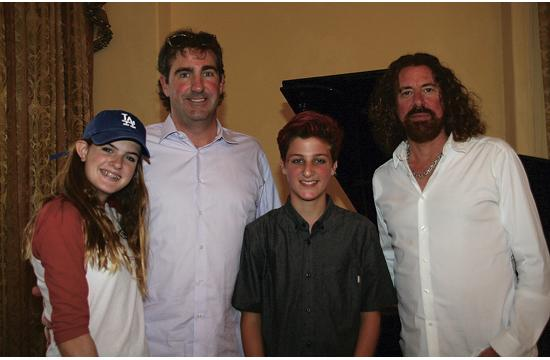 Singers/musicians Grace and Clayton Davis with their father
