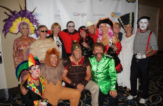 The Meals on Wheels West Board of Directors and staff showing off their costumes at the Monster Bash.