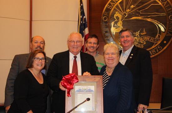 Retiring Santa Monica councilman Bob Holbrook (center) with fellow council members Gleam Davis