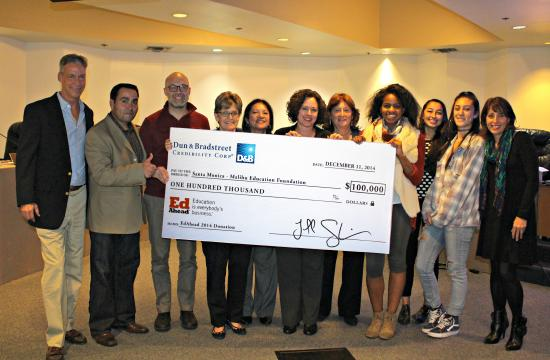 SMMEF Executive Director Linda Greenberg Gross (fourth from left) receives a check from Judy Hackett