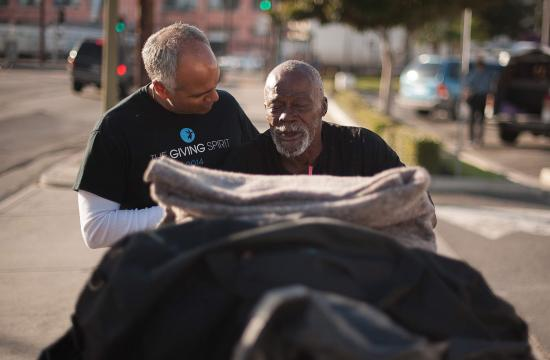 The Giving Spirit's founder Tom Bagamane (left) with a homeless client.