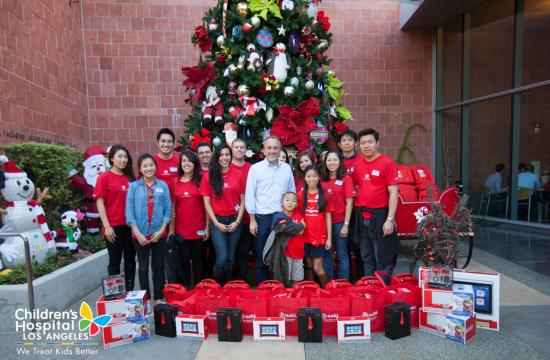 The Fuhu team at Children's Hospital Los Angeles. They handed out tablets to 100 patients at CHLA last week. The man in the middle is Fuhu CEO Jim Mitchell.
