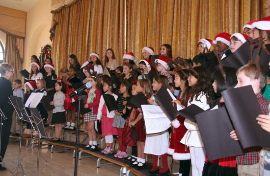Students from Carlthorp School spread cheer through song at the final Santa Monica Rotary meeting of 2014.