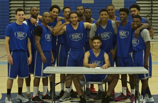 Santa Monica College basketball star player Derrien King (sitting) has signed to Washington State.
