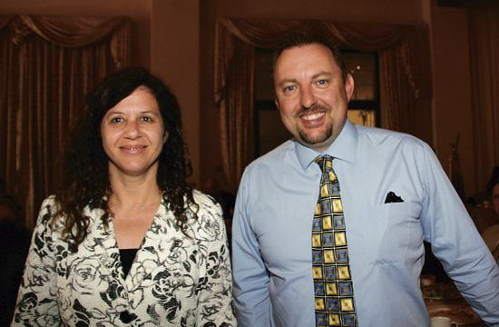 Rotarian Sharon Perlmutter Gavin and Kevin O. McKeown of the Samohi band program.